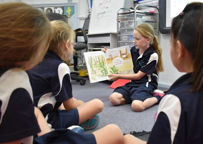 student reading to class